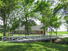 Wedding ceremony location. One of a kind bridge aisle that crosses the creek to the white chapel gazebo.
