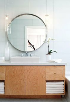 Modern Bathroom, smart wood cabinet design under countertop basin, round mirror