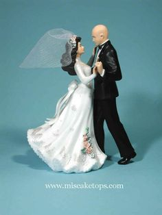 Bald groom with bride. Look I found Evan! Perfect cake topper! Hahaha