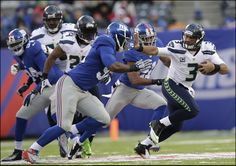 A look at the Giants' 2014 strength of schedule based on opponents' 2013 record Seattle Sights, Seattle News, Football Players, Football Helmets, Nfc West, Russell Wilson, Seattle Seahawks, New York Giants