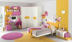 Kids Bedroom : Girls Bedroom Ideas Corner Run Wardrobes Floating Shelves Design Pink Workspace Computer Desk Chair Wall Book Storage Decor Grey Pattern Quilt White Bedding Yellow Shag Rug Table Some Important Point You Should Obey During Kids Bedroom Development Kids Bedroom Development. Kids Bedroom Ideas. Kids Rooms.