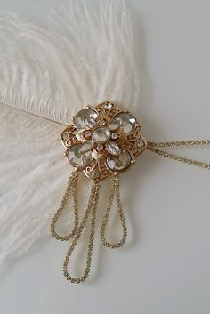 Nouveau Flapper Hairpiece Stunning dainty glass rhinestone strands cross your forehead to meet a large vintage inspired brooch. Dangling from the brooch
