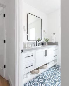 White and blue mosaic floor tiles accent a lovely white and blue bathroom boasti. - White and blue mosaic floor tiles accent a lovely white and blue bathroom boasting a white washstan - White Bathroom Cabinets, Bathroom Floor Tiles, White Cabinets, Tile Floor, White Vanity Bathroom, Bathroom Black, Concrete Bathroom, Shower Tiles, Mirror Bathroom