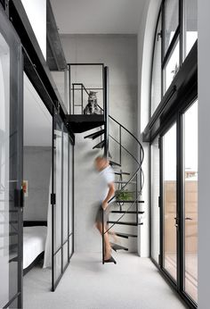 Arched openings punctuate the brick facade of this apartment building in Amsterdam by WE Architecten, which is co-owned by its occupants Spiral Staircase, Staircase Design, Staircase Ideas, Stair Design, Staircases, Spiral Stairs Design, Minimal Apartment, Duplex Apartment, Architecture Design