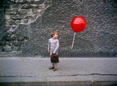 The Red Balloon (French: Le Ballon rouge) is a 1956 fantasy featurette directed by French filmmaker Albert Lamorisse.[1] The thirty-four minute short, which follows the adventures of a young boy who one day finds a sentient, mute, red balloon, was filmed in the Ménilmontant neighborhood of Paris. It won numerous awards, including an Oscar for Lamorisse for writing the best original screenplay in 1956 and the Palme d'Or for short films at the 1956 Cannes Film Festival. <3 <3 <3 <3 <3 <3 <3 <3...