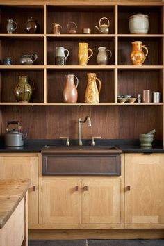See all our stylish kitchen design ideas. Oak shelves Display Ceramics Over Sink.