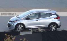 With these shots of the #Chevrolet Bolt EV, we can see more of this new electric car than ever before. This car could even get up to 200 miles! Where would you go in 200 miles? http://www.caranddriver.com/news/2017-chevrolet-bolt-ev-spied-undisguised-news