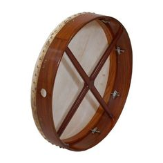 "Bodhran, 18""x3.5"", Tune, Rosewood, Cross by Roosebeck. $86.62. Bodhran, 18""x3.5"", Tune, Rosewood, Cross. This solid rosewood frame has a fixed crossbar for support. The bolt tuning is hidden on the inside of the frame. You will love the sound of the natural goatskin head. Easy and fun to play. The enclosed product insert will give you the basics to get started. Includes a tipper and a tuning wrench."