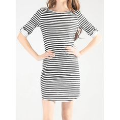Playing it safe with fashion isn't always a good thing. But in this case -- a UPF 50+ striped dress with a chic, full-coverage boat neckline -- it's a great thing. /