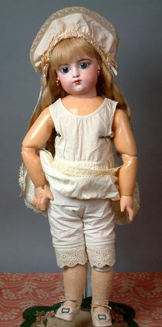 An exquisite bebe, this beautiful closed mouth girl with her fabulous costume will make a most delightful addition to anyones collection. Long flowing