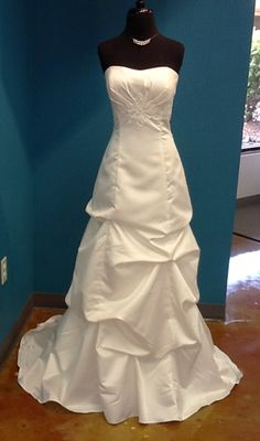 Beautiful modified a-line wedding dress with pick-ups and lace