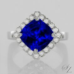 There seems no end to the velvety blue depths of this remarkable Tanzanite. Set in a shimming halo of fine Diamonds and set on the diagonal to give the ring a modern, eye catching twist. Heavenly!