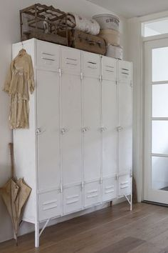 """Great Mudroom idea -- everyone gets their own """"locker"""" and the clutter of coats and outerwear get tucked neatly away."""