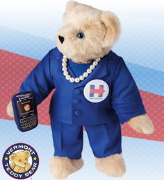 Hillary Bear | On a mission, Hillary Bear always has her BlackBEARy in paw. She knows that with just one missed call, things can get grizzly. Dressed in a Cobalt Blue pantsuit, faux pearls and campaign pin. Handmade in Vermont, USA using the softest fur we can get our hands on and 100% recycled stuffing. Guaranteed for life.