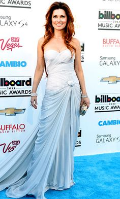 Shania Twain in a lavender strapless gown from the spring/summer 2013 PAVONI by Mikael D. Collection.