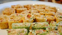 Spicy Chicken Tortilla Roll-Ups....perfect for a hunting appetizer, or maybe a day of scrapping.  Not to mention good football watching food!