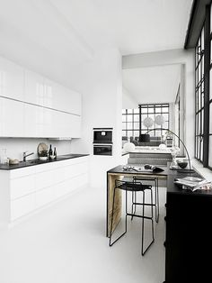 Black and white kitchen via Kvik