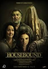 Housebound (2014)   Kylie Bucknell is forced to return to the house she grew up in when the court places her on home detention. Her punishment is made all the more unbearable by the fact she has to live there with her mother Miriam - a well-intentioned blabbermouth who's convinced that the house is haunted.