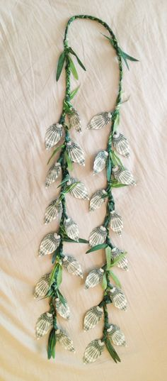Beautiful money lei made with money leaves.  Perfect for graduations, weddings, and more!
