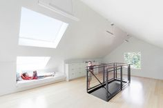 Fantastic attic remodel.  An added benefit of installing the skylights was adding headroom over the day beds, Smith says.  Photo by: Ye-h Photography