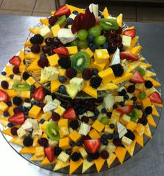 A Cheese tray for 50-75 people.  I garnished it with fresh fruit.  Cheers!