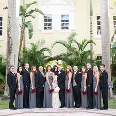 Black bridesmaids, grey tops for guys, and red and coral colored flowers... Close to the same colors!