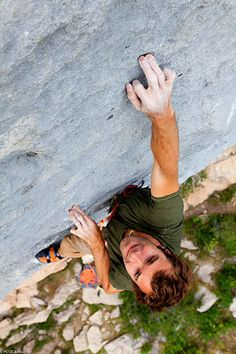 Repulsive & Fascinating all at the same time. Finger tips - Chris Sharma rock climbing in Ceuse, France  © Lafouche
