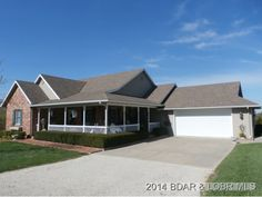 EXQUISITE PROPERTY Pride of ownership doesn't begin to describe this beautiful home & acreage in  Versailles MO