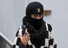 Checkmate! Beyonce wins this fashion match in a checkered coat, which she pairs with a swank Louis Vuitton ski mask and heavy kohl eyeliner on Nov. 12, 2013 while leaving a studio in Los Angeles, where she was believed to be shooting a new video.