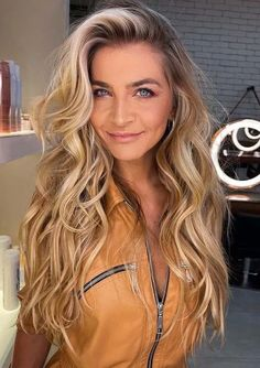 You may find here stunning shades of golden blonde hair colors for long hair to sport in 2021. All the beautiful ladies may wear this unique hair color for more cute hair colors look in current year. Moreover, this amazing hair color can also be try a medium haircuts for bold or trendy hair looks.