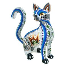 This beautiful cat is so graceful and elegant! Luis and Margarita Sosa created this delightful figure and decorated it with their classic painted designs.  They are the parents of Aurora Sosa and you can see where she got her talent from!