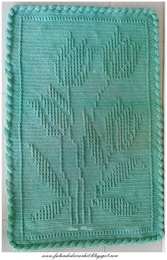 Crochet rug. Looks like a front post stitch is the raised section. There is a chart if you wanted to give it a try. Inspiration !!