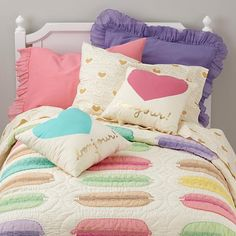 don't like the bedspread, but I like the heart pillows! in turquoise or pink, for A's bed