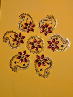 This is a set of beautiful handcrafted art pieces - has one circular piece surrounded by 6 individual pieces - can be used as traditional floor decoration as Rangoli, or set on table top or can be wall mounted as art work. This is done on a clear acrylic sheet & the stones, pearls & the other gold color decorative pieces are adhered well - it is a delicate looking but sturdy piece. The pieces can be arranged in different ways to change the finished look. Arrangements can be made for ...