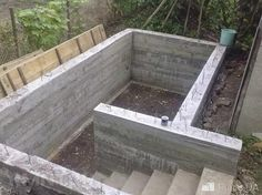 When SHTF if you have an underground bunker in your backyard, you are going to be a lot safer than your complacent neighbors. Here's how to build one. Underground Bunker Plans, Underground Cellar, Underground Shelter, Underground Homes, Piscine Diy, Safe Room, Construction Services, Survival Shelter, Basement Stairs