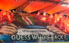Legia Warsaw fans display a giant banner on their return to the Champions League