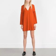 Zara orange long sleeve dress Beautiful ornamented loose sleeve. V neck bohemian style dress. Simple and easy to match. Size M. This was mailed from Tokyo and due to some shipping problem all clothes in this batch had to remove their tags. But this is completely new for sure. Zara Dresses