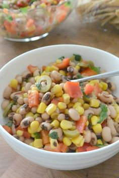 Black-Eyed Peas and Corn Salad is perfect for New Year's Day or any day of the year! Combine black-eyed peas, corn, red bell pepper, green olives, and a tangy dressing for a flavorful healthy dish. #blackeyedpeas #salad #vegan #glutenfree via @VeggiesSave