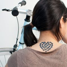 Cute Heart bicycle chain tattoo on the neck.