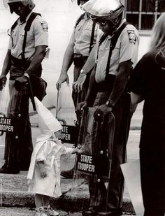 In1922, this encounter between a little boy dressed up as part of  the Ku Klux Klan and a black cop from the Trooper State, took place.