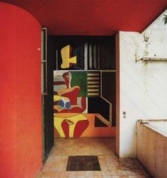 Le Corbusier altered the entrance of Gray's villa by painting over her mural with his own. Photo courtesy of Foundation Le Corbusier.