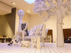 Storefront Story Romances  The Hugo Boss Storybook Window Display Tells a Charming Tale