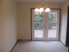 12.6 x 12 formal dining room with brand new French doors leading to the large deck.