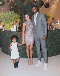 Khloe Kardashian Shares New Family Pics With Tristan Thompson - E! Online Tristan Thompson And Khloe, Khloe And Tristan, Khloe Kardashian And Tristan, Khloe Kardashian Show, Light Grey Suits, Jenner Family, White Sleeveless Dress, Bridesmaid Dresses, Wedding Dresses