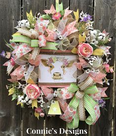 What a sweet Spring wreath for your door or wall to display. This Spring Floral cow wreath is made on a burlap mesh base and is accented with various Spring ribbon with a touch of cowprint, Spring florals and topped off with a yellow cowbell to complete this wreath. Your family