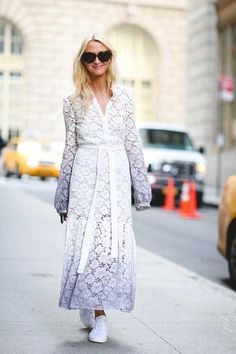 ELLE loves... Zanna Rossi at NYFW wearing a white lace Burberry maxi dress, perfectly matched with a pair of white trainers and sunglasses.