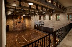 Indoor basketball court with rock climbing wall