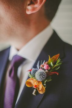 tropical boutonniere - photo by Brian Evans Photography http://ruffledblog.com/vibrant-eclectic-wedding-in-palm-springs