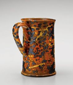"""Mug, attributed to Solomon Loy, Alamance County, North Carolina, 1825-1840. Lead-glazed earthenware. H. 6 1/2"""".  (Private collection.) --- Art in Clay: Masterworks of North Carolina Earthenware by Old Salem Museums and Gardens, Chipstone Foundation, and Caxambas Foundation."""