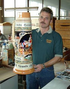 That is one hell of a beer stein - awesome!! (Google Image Result for http://www.germansteins.com/product_images/uploaded_images/large-german-beer-stein-by-king-werk.jpg)